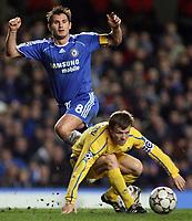 Photo: Paul Thomas.<br /> Chelsea v Levski Sofia. UEFA Champions League, Group A. 05/12/2006. <br /> <br /> Chelsea's captain Frank Lampard (L) passes the ball around Levski's captain Elin Topuzakov.