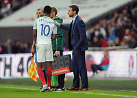 Football - 2017 / 2018 FIFA World Cup Qualifier - UEFA Group F: England vs. Slovenia<br /> <br /> England Manager Gareth Southgate puts a hand on Marcus Rashford as he complains to the fourth official at Wembley.<br /> <br /> COLORSPORT/ANDREW COWIE