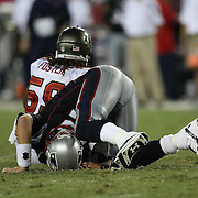 New England quarterback Tom Brady (12) falls to the ground after being hit by Tampa bay linebacker Mason Foster (59) during an NFL football game between the New England Patriots and the Tampa Bay Buccaneers at Raymond James Stadium on Thursday, August 18, 2011 in Tampa, Florida.   (Photo/Alex Menendez)