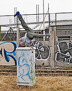 Breakdancer dancing on a electricity street box