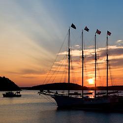 Sunrise in Bar Harbor near Maine's Acadia National Park.  Four-masted schooner, The Margaret Todd.