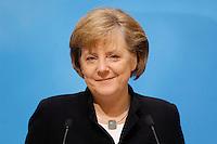 23 JAN 2006, BERLIN/GERMANY:<br /> Angela Merkel, CDU Bundesvorsitzende und Bundeskanzlerin, waehrend einer Pressekonferenz, Konrad-Adenauer-Haus<br /> Angela Merkel, Federal Chancellor of Germany, during a press conference, Konrad-Adenauer-Haus<br /> IMAGE: 20060123-02-014<br /> KEYWORDS: freundlich