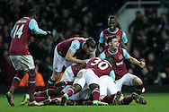 Angelo Ogbonna Obinze of West Ham United (hidden) celebrates scoring his sides 2nd goal during 2nd Extra time to make it 2-1 as he is mobbed by his teammates. The Emirates FA cup, 4th round replay match, West Ham Utd v Liverpool at the Boleyn Ground, Upton Park  in London on Tuesday 9th February 2016.<br /> pic by John Patrick Fletcher, Andrew Orchard sports photography.