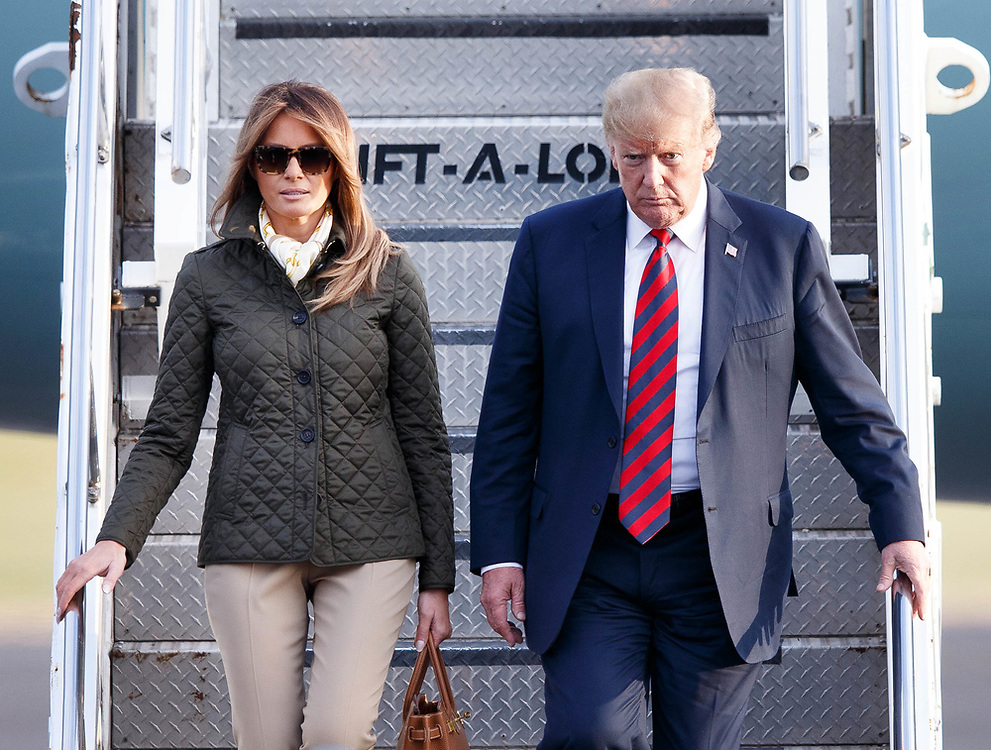 US President Donald J. Trump (R) and First Lady Melania Trump (L) arrive at Prestwick Airport, Ayrshire, Scotland ahead of a visit to Trump Turnberry golf course. 13 July 2018. US President Trump is on a three-day working visit to the United Kingdom, his first trip to the country as US president. EPA/EFE ROBERT PERRY