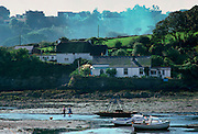 Two women and a dog at Gillan Harbour, Helford River Estuary, Cornwall, England