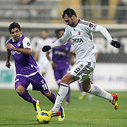 Besiktas's Hugo Almedia (R) and Orduspor's Juan Emmanuel Culio (L) during their Turkish superleague soccer match Besiktas between Orduspor at Mardan Stadium in Antalya Turkey on Monday, 05 December 2011. Photo by TURKPIX