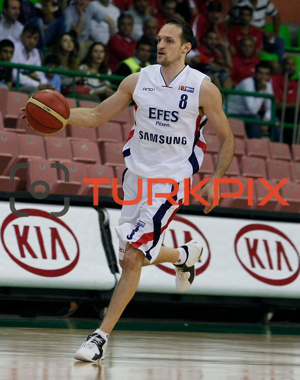 Efes Pilsen's Igor RAKOCEVIC during their Turkish Basketball league Play Off semi final first match Efes Pilsen between Besiktas at the Ayhan Sahenk Arena in Istanbul Turkey on Sunday 09 May 2010. Photo by Aykut AKICI/TURKPIX