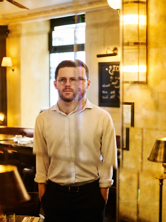 """David Amiel, Political advisor to the President of the French Republic, and essayist, posing at the """"Comptoir du Pantheon"""", a cafe. Paris, France. March 5, 2019.<br /> David Amiel, conseiller du President de la Republique Francaise et essayiste, posant au """"Comptoir du Pantheon"""". Paris, France. 5 mars 2019."""