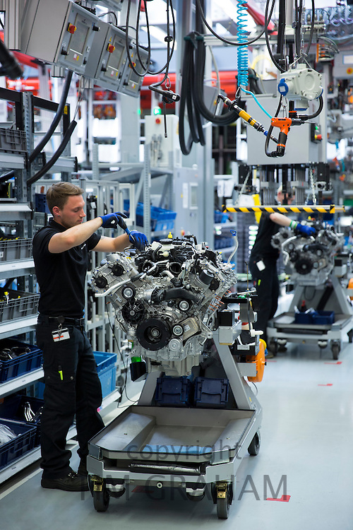 Mercedes-AMG engine production factory in Affalterbach, Germany - engineer at work hand-building one complete M157 5.5L V8 biturbo engine