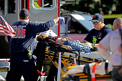Medical personnel tend to a victim outside of Stoneman Douglas High School in Parkland, FL, USA after reports of an active shooter on Wednesday, February 14, 2018. Photo by John McCall/Sun Sentinel/TNS/ABACAPRESS.COM