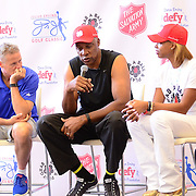 PHILADELPHIA, PA - SEPTEMBER 12:  (L-R) Brett Brown, Julius Erving, Jasmine Erving and Christian Crosby talk to children during Q & A at The Julius Erving Youth Basketball Experience at the Salvation Army Kroc Center on September 12, 2015 in Philadelphia, Pennsylvania.  (Photo by Lisa Lake/Getty Images for the Julius Irving Golf Classic)