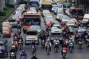 18 MARCH 2009 -- BANGKOK, THAILAND:  Traffic passes from south to north on Ratchadamri across Phloenchit in Bangkok, Thailand. Photo By Jack Kurtz