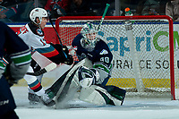 KELOWNA, BC - MARCH 6: Alex Swetlikoff #17 of the Kelowna Rockets stops at the net of Blake Lyda #40 of the Seattle Thunderbirds during second period at Prospera Place on March 6, 2020 in Kelowna, Canada. (Photo by Marissa Baecker/Shoot the Breeze)