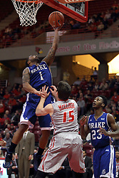07 January 2015:   Karl Madison gets a layup off before Justin McCloud can get better position during an NCAA MVC (Missouri Valley Conference) men's basketball game between the Drake Bulldogs and the Illinois State Redbirds at Redbird Arena in Normal Illinois.  Illinois State comes out victorious 81-45.