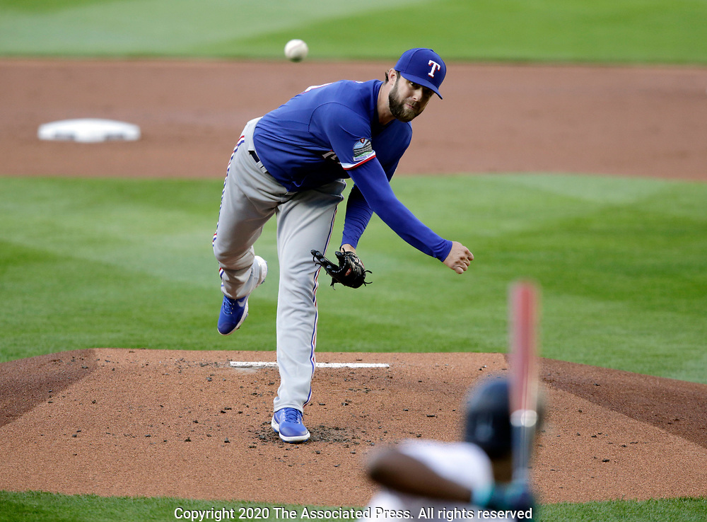 Texas Rangers starting pitcher Jordan Lyles works against the Seattle Mariners during the first inning of a baseball game, Saturday, Aug. 22, 2020, in Seattle. (AP Photo/John Froschauer)