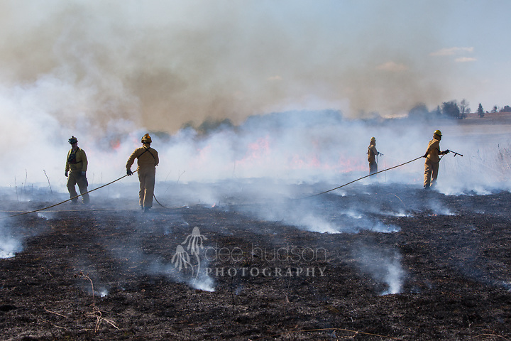 The crew works together as a team to attack the fire.