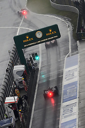19.04.2014, International Circuit, Shanghai, CHN, FIA, Formel 1, Grand Prix von China, Qualifying Tag, im Bild Cars exit pit lane. // during the Qualifyingday of Chinese Formula One Grand Prix at the International Circuit in Shanghai, China on 2014/04/19. EXPA Pictures © 2014, PhotoCredit: EXPA/ Sutton Images<br /> <br /> *****ATTENTION - for AUT, SLO, CRO, SRB, BIH, MAZ only*****