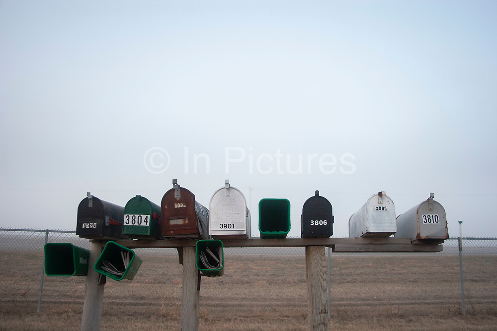 Line of post boxes in the early morning mist at a truck stop in Minot, North Dakota, United States.