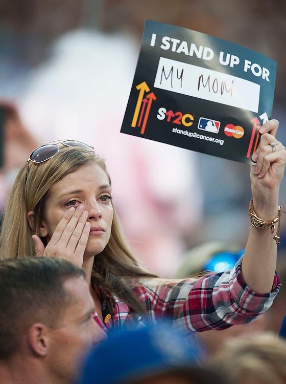 A fan cries during a Stand Up 2 Cancer moment, during the 2016 MLB All-Star Game at Petco Park in San Diego on Tuesday.<br /> <br /> ///ADDITIONAL INFO:   <br /> <br /> allstar.0713.kjs  ---  Photo by KEVIN SULLIVAN / Orange County Register  -- 7/12/16<br /> <br /> The 2016 MLB All-Star Game at Petco Park in San Diego.