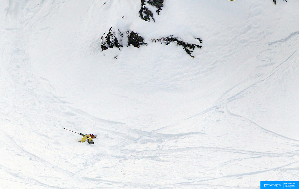 Freeskier Ted Davenport of the United States launches off a drop which resulted in him tragically breaking both  legs landing on hard rock just below the surface of the snow. Davenport was competing in the World Heli Challenge Extreme Day at Mount Albert on Minaret Station, Wanaka, New Zealand and was the two times defending champion. His first run had resulted in a bad fall and a broken ski. His injures included a broken tibia and fibula. Emergency services reached Davenport who was air lifted to Wanaka Lake Health Centre then on to Dunedin hospital for surgery. He is due to marry in a few weeks time. 1st August 2011. Photo Tim Clayton