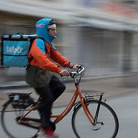 Currier is seen delivering food as restaurants closed as part of the COVID-19 pandemic restrictions in Budapest, Hungary on Nov. 11, 2020. ATTILA VOLGYI