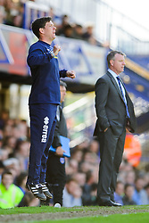 Manager Darrell Clarke (ENG) of Bristol Rovers jumps up nervously as Manager Andy Awford (ENG) of Portsmouth looks on - Photo mandatory by-line: Rogan Thomson/JMP - 07966 386802 - 19/04/2014 - SPORT - FOOTBALL - Fratton Park, Portsmouth - Portsmouth FC v Bristol Rovers - Sky Bet Football League 2.