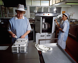 Meals on Wheels food being prepared in kitchen Haringey London UK