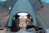 Jeju Island, South Korea - September 15, 2019: Two friends enjoy the end of a day at Jungmun Beach on Jeju Island, South Korea.