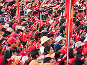 01 NOVEMBER 2015 - YANGON, MYANMAR:  The crowd listens to Aung San Suu Kyi at the NLD's last election rally of the 2015  election in the Yangon suburbs Sunday. Political parties are wrapping up their campaigns in Myanmar (Burma). National elections are scheduled for Sunday Nov. 8. The two principal parties are the National League for Democracy (NLD), the party of democracy icon and Nobel Peace Prize winner Aung San Suu Kyi, and the ruling Union Solidarity and Development Party (USDP), led by incumbent President Thein Sein. There are more than 30 parties campaigning for national and local offices.     PHOTO BY JACK KURTZ