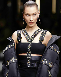 """Bella Hadid releases a photo on Instagram with the following caption: """"Versace Mens show in Milan tonight-\nNo energy like the energy @ Versace !!! You are the most wonderful, ILoveYou @donatella_versace @kjeldgaard1 @pg_dmcasting @samuel_ellis @guidopalau @patmcgrathreal \ud83d\udda4\ud83d\ude4f\ud83c\udffc\ud83d\udda4"""". Photo Credit: Instagram *** No USA Distribution *** For Editorial Use Only *** Not to be Published in Books or Photo Books ***  Please note: Fees charged by the agency are for the agency's services only, and do not, nor are they intended to, convey to the user any ownership of Copyright or License in the material. The agency does not claim any ownership including but not limited to Copyright or License in the attached material. By publishing this material you expressly agree to indemnify and to hold the agency and its directors, shareholders and employees harmless from any loss, claims, damages, demands, expenses (including legal fees), or any causes of action or allegation against the agency arising out of or connected in any way with publication of the material."""
