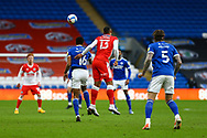 Cardiff City's Curtis Nelson (16) under pressure from Millwall's Kenneth Zohore (13) during the EFL Sky Bet Championship match between Cardiff City and Millwall at the Cardiff City Stadium, Cardiff, Wales on 30 January 2021.