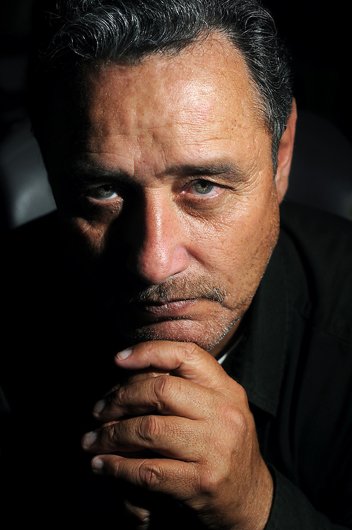 Robin Zielinski – Sun-NewsRJ Hernandez poses for a photograph on Thursday at his home in Las Cruces. Hernandez was recently fired after being the whistleblower in an identify theft scheme involving numerous County Clerk employees.