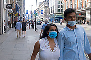 As Britain enters a period of deep recession, with some shops closing either temporarily or permanently as the economic downturn caused by the Covid-19 pandemic cuts hard, shoppers wearing face masks continue to come to the West End to Oxford Street on 13th August 2020 in London, United Kingdom. The Office for National Statistics / ONS has announced that gross domestic product / GDP, the widest gauge of economic health, fell by 20.4% in the second quarter of the year, compared with the previous quarter. This is the biggest decline since records began. The result is that Britain has officially entered recession, as the UK economy shrank more than any other major economy during the coronavirus outbreak.