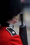 A guardsman stands to attention before the funeral of Margaret Thatcher. Draped in the union flag and mounted on a gun carriage, the coffin of ex-British Prime Minister Baroness Margaret Thatcher's coffin travels along Fleet Street towards St Paul's Cathedral in London, England. Afforded a ceremonial funeral with military honours, not seen since the death of Winston Churchill in 1965, family and 2,000 VIP guests (incl Queen Elizabeth) await her cortege. Margaret Hilda Thatcher, Baroness Thatcher (1925 - 2013) was a British politician who was the Prime Minister of the United Kingdom from 1979 to 1990 and the Leader of the Conservative Party from 1975 to 1990, the longest-serving British Prime Minister of the 20th century and the only woman to have held the office to date.