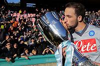 Gonzalo Higuain Napoli con la Supercoppa TIM <br /> Gonzal Higuain kisses the italian supercup <br /> Napoli 02-01-2015 Stadio San Paolo <br /> Football Calcio Serie A Napoli - Supercoppa TIM 2014-2015<br /> Foto Cesare Purini / Insidefoto