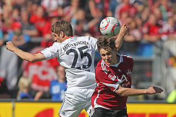 09.04.2011, easy Credit Stadion, Nuernberg, GER, 1 FC Nuernberg vs FC Bayern Muenchen, im Bild:  Kopfballduell zwischen Philipp Wollscheid (Nuernberg #38) und Thomas Mueller (Muenchen #25).EXPA Pictures © 2011, PhotoCredit: EXPA/ nph/  news       ****** out of GER / SWE / CRO  / BEL ******