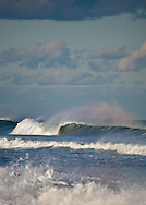 A brief rainbow appeared in the spray of a breaking wave at Nauset Beach in Orleans.
