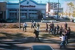 Dec 26th, 2005. Video grab courtesy New Orleans Channel 4 TV. Video showing knife wielding Anthony Hayes, left, (38 yrs) confronted by New Orleans police officers before he was gunned down on St Charles Avenue.