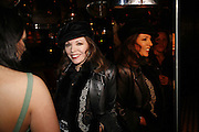 Martine McCutcheon and Joan Collins, Spring party at Frankie Dettori's bar and Grill. 3 Yeoman's Row. London sw3. 10 April 2006. ONE TIME USE ONLY - DO NOT ARCHIVE  © Copyright Photograph by Dafydd Jones 66 Stockwell Park Rd. London SW9 0DA Tel 020 7733 0108 www.dafjones.com