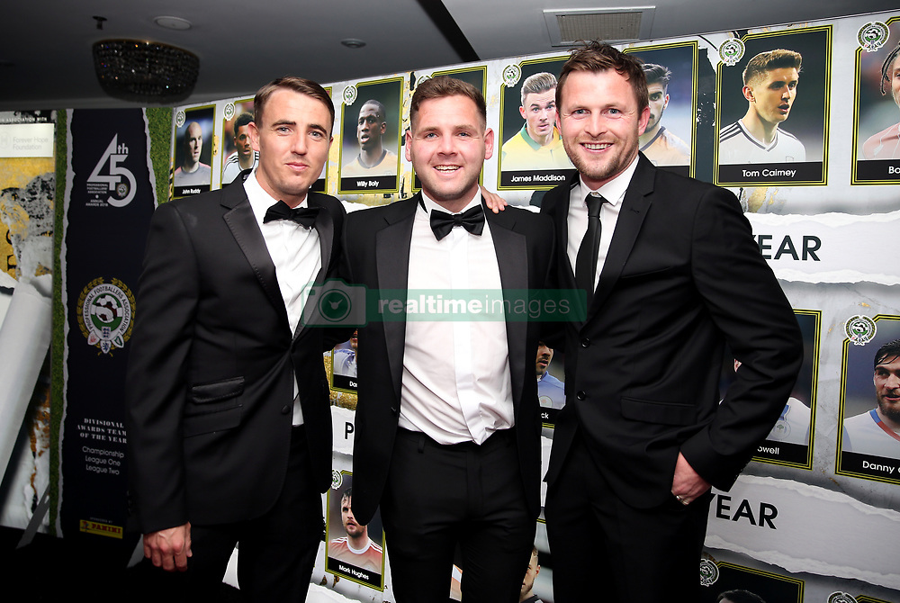 Accrington Stanley's (left-right) Guest, Billy Kee and Mark Hughes during the 2018 PFA Awards at the Grosvenor House Hotel, London.