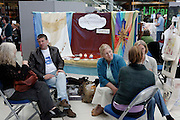 People discussing dream interpretation at alternative therapy wellbeing session in Norwich, England