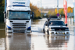 South Yorkshire flooding. Ickles Roundabout Rotherham. As Specialist rescue teams from the West Midlands Fire service rescue people from vehicles and business premises along the A6178 Sheffield Rd a four wheel drive makes its way through flood water which in places is up to chest deep as the driver breathes a sigh of relief<br /> <br />  Copyright Paul David Drabble<br />  07 November 2019<br />  www.pauldaviddrabble.co.uk