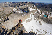 Jeremiah Kahmosen climbs the North Ridge of Mt. Conness (12,590 ft.) on the border of Yosemite National Park, Sierra Nevada Mountains, California