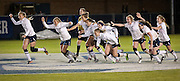 BYU players rush in after scoring the winning penalty kick during the NCAA Women's Soccer Sweet 16 match between BYU and Marquette University at BYU,Saturday, Nov. 17, 2012.