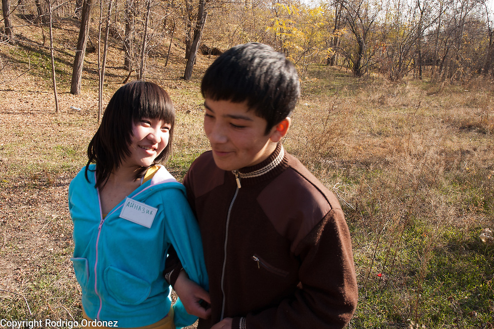 A girl and a boy rehearse a small drama piece based on a fairy tale during a teambuilding exercise in Osh (Kyrgyzstan). This activity gathered students, parents, relatives and teachers from 30 schools in Osh province where Save the Children carries out peace and reconciliation activities.