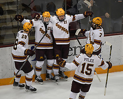 November 17, 2017 - Minneapolis, MN, USA - Teammates celebrated with Minnesota Golden Gophers forward Casey Mittelstadt (21) after Mittelstadt scored a goal in the second period against Harvard on Friday, Nov. 17, 2017, at the 3M Arena at Mariucci in Minneapolis. (Credit Image: © Aaron Lavinsky/TNS via ZUMA Wire)