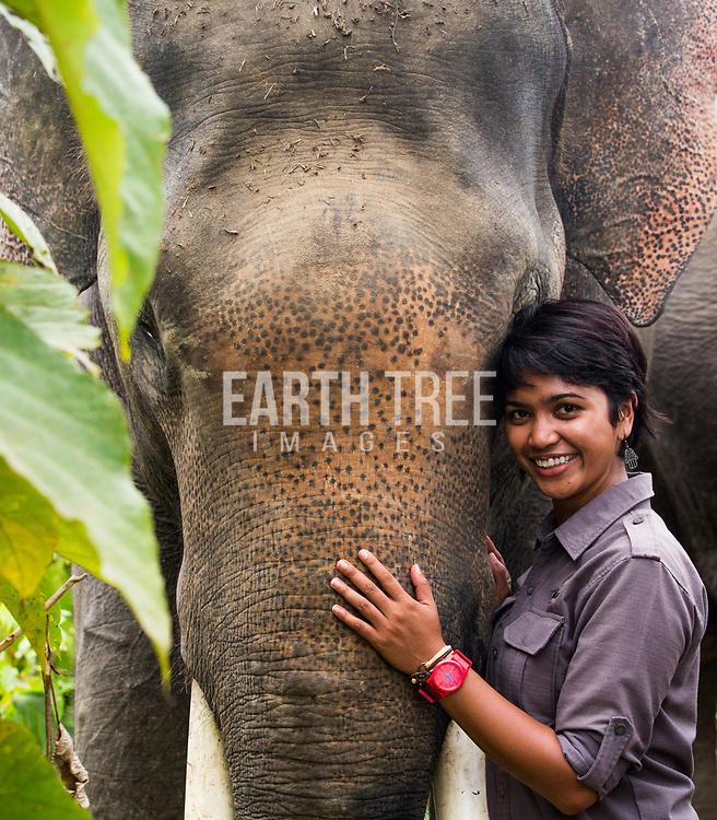 Farwiza Farhan, Chairperson of the NGO, HAkA. Bonds with a captive Sumatran Elephant within the Leuser Ecosystem. Photo: Paul Hilton