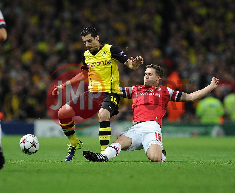 Arsenal's Aaron Ramsey tackles Borrusia Dortmund's Henrik Mkhitaryan- Photo mandatory by-line: Alex James/JMP - Tel: Mobile: 07966 386802 22/10/2013 - SPORT - FOOTBALL - Emirates Stadium - London - Arsenal v Borussia Dortmund - CHAMPIONS LEAGUE - GROUP F