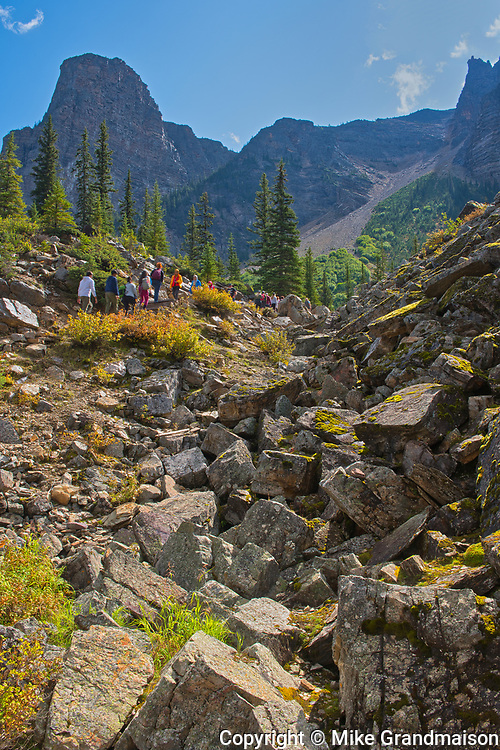 Hikers on The Rock Pile at the east end of Moraine Lake<br />Banff National Park<br />Alberta<br />Canada