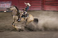 October 1st, 2011. Pico Rivera, California. Traditional charros (Mexican cowboys) compete in a Mexican Rodeo. The competition at the Pico Rivera Sports Arena is a display of horsemanship and lasso skills. Pictured is Martin Alamillo Jr (11). sliding his horse..PHOTO © JOHN CHAPPLE / www.johnchapple.com